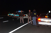 """Frederick, MD - October 24, 2002 -- Frederick County (MD) Sheriffs Deputies and ATF agents block traffic along I-70 as they investigate a vehicle believed to belong to the """"Beltway Sniper"""".<br /> Credit: Ron Sachs / CNP<br /> (RESTRICTION: NO New York or New Jersey Newspapers or newspapers within a 75 mile radius of New York City)"""