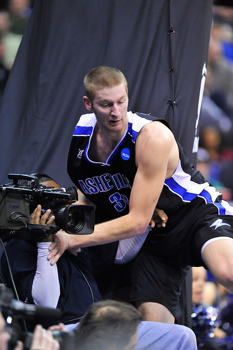 D.J. Cunningham of the Bulldogs lands on a cameraman. Pittsburgh defeated UNC-Asheville 74-51 during the NCAA tournament at the Verizon Center in Washington, D.C. on Thursday, March 17, 2011. Alan P. Santos/DC Sports Box