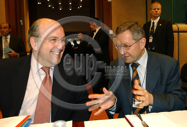 Brussels-Belgium - May 10, 2004---Meeting of the EUROGROUP at the 'Justus Lipsius', seat of the Council of the European Union in Brussels; here, Joaquin (Joaquín) ALMUNIA (le), European Commissioner for Economic and Monetary Affairs, with his Director General, Klaus REGLING (ri)---Photo: Horst Wagner/eup-images