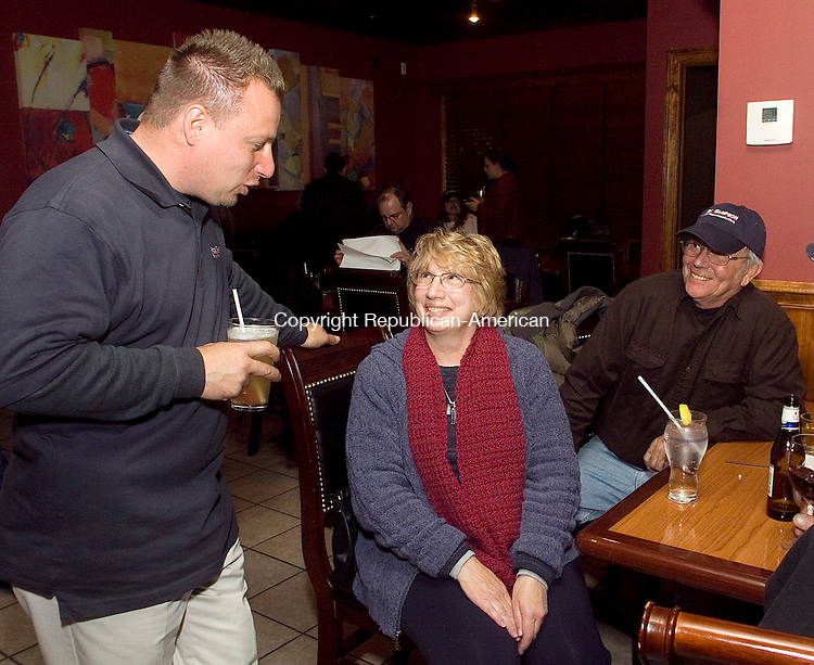 WOLCOTT, CT.-02 NOVEMBER 2010-110210DA02- Newly elected State Rep. Robert C. Sampson R-Wolcott celebrates his victor for  the 80th House District with his mom Margaret and his dad Charlie Sampson at the River in Wolcott Tuesday night. Sampson won the tight race against the former State Rep. John &quot;Corkey&quot; Mazurek D-Wolcott.<br /> Republican-American Darlene Douty