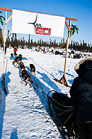 Cim Smyth crosses under the GCI half-way banner at the Cripple checkpoint during the 2010 Iditarod, Interior Alaska