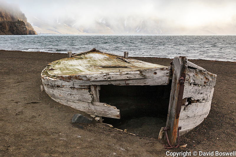 The remains of a water boat on the beach of Whalers Bay, Deception Island stands testament to the whaling history in the Antarctic region.  Water boats were used to bring freshwater from the land to the whaling ships anchored in the bay.   Deception Island is part of the South Shetland islands near the Antarctic Peninsula.
