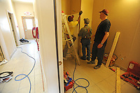 "Volunteers transform a former funeral parlor into a homeless shelter for families and single women at the Faith Mission in Elkhart, Indiana on April 8, 2009.  Elkhart has seen a surge in unemployment in the last year from 4.5% in 2008 to 20% this year and Obama has visited the town three times, including his first stop after arriving in Washington as the U.S. President to promote ""bail out"" and stimulus spending during the current global recession."