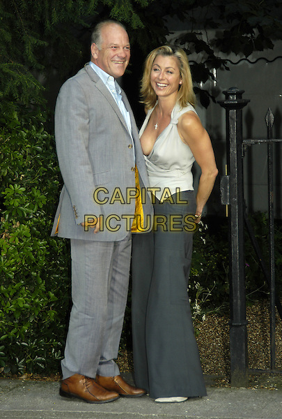UNNAMED & SUZANNE DANDO.David Frost's Summer Party.London 6 July 2004..full length low cut top cleavage wide leg trousers.Ref: PL.www.capitalpictures.com.sales@capitalpictures.com.©Capital Pictures