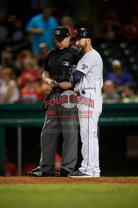 Bowling Green Hot Rods manager Craig Albernaz (1) talks with home plate umpire Steven Jaschinski during a game against the Peoria Chiefs on September 15, 2018 at Bowling Green Ballpark in Bowling Green, Kentucky.  Bowling Green defeated Peoria 6-1.  (Mike Janes/Four Seam Images)