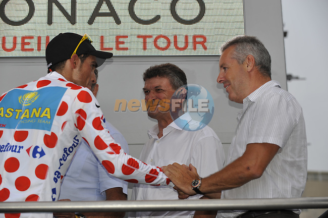 Astana team rider Alberto Contador (ESP) takes the first King of Mountains Polka Dot Jersey being congratulated by former winner Stephen Roche (IRL) on the podium at the end of the Prologue Stage 1 of the 2009 Tour de France a 15.5km individual time trial held around Monaco. 4th July 2009 (Photo by Eoin Clarke/NEWSFILE)