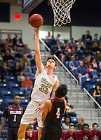 Springdale Bulldogs vs Bentonville West Woverines Basketball - Boston Barron (33) of Bentonville goes up for the shot as Joe Jibke (4) draws the charge at Wolverine Arena, Bentonville, AR on February 9, 2018.   Special to NWA Democrat-Gazette/ David Beach
