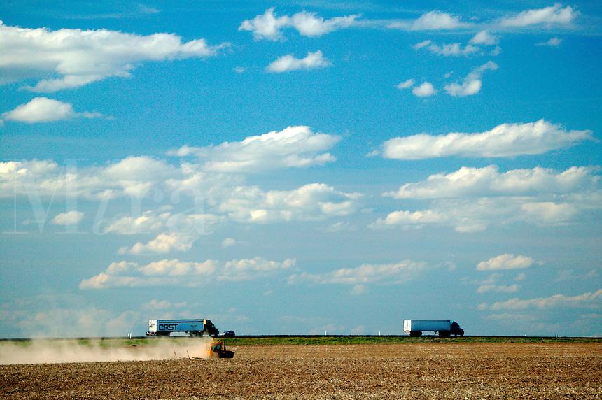 A farmer working the fields along I-90 on farmland near Ritzville, Eastern Washington
