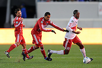 Macoumba Kandji (10) of the New York Red Bulls is chased by Julio Martinez (6) of the Chicago Fire during the first half of a Major League Soccer match between the New York Red Bulls and the Chicago Fire at Red Bull Arena in Harrison, NJ, on March 27, 2010. The Red Bulls defeated the Fire 1-0.