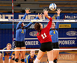 BROOKINGS, SD - SEPTEMBER 25:  Ashley Beaner #11 and Ashlynn Smith #4 from South Dakota State University try to block the kill attempt from Rachel Schmidt #11 from the University of South Dakota  during their match Sunday afternoon at Frost Arena. (Photo by Dave Eggen/Inertia)