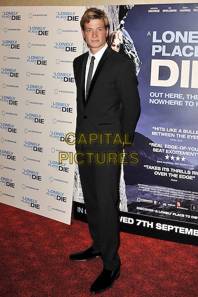 Ed Speleers.UK premiere of 'A Lonely Place To Die' at Empire Leicester Square, London, England. .September 7th, 2011.full length suit tie white shirt .CAP/MAR.© Martin Harris/Capital Pictures.
