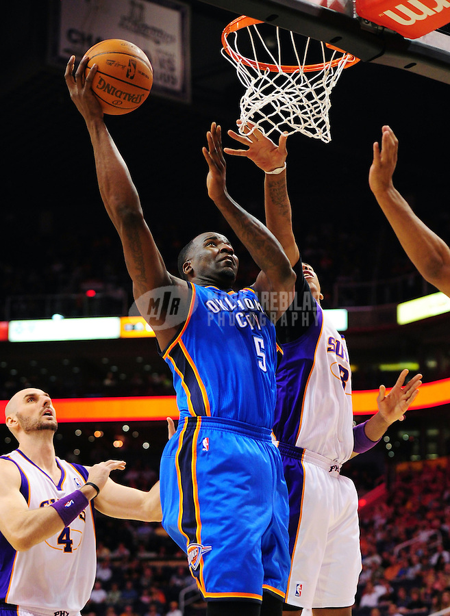 Mar. 30, 2011; Phoenix, AZ, USA; Oklahoma City Thunder center (5) Kendrick Perkins drives to the basket in the first half against the Phoenix Suns at the US Airways Center. Mandatory Credit: Mark J. Rebilas-