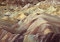Eroded bad lands of Golden Canyon, Death Valley National Park, Californi