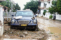 A Mercedes taxi on a pile of mud and debris in Agia Triada