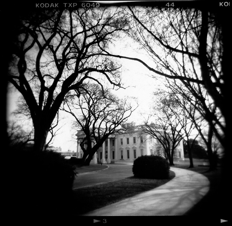 General  - Pictorial<br /> <br /> Washington DC:  The White House, surrounded by the bare, leafless trees of spring.  April, 2001