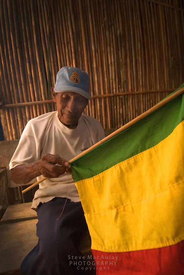 Old man sewing flag by hand, Comarce de Kuna Yala, San Blas Islands, Panama