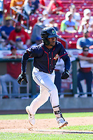 Cedar Rapids Kernels second baseman Yeltsin Encarnacion (43) runs to first base during a Midwest League game against the Peoria Chiefs on May 26, 2019 at Perfect Game Field in Cedar Rapids, Iowa. Cedar Rapids defeated Peoria 14-1. (Brad Krause/Four Seam Images)