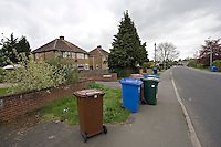 Household dustbin placed on front garden ready for collection.©shoutpictures.com..john@shoutpictures.com