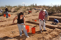 Marty Robistow who is finishing his undergraduate work at the University of Arizona shovels dirt from the Marana Platform Mound with University of Hawaii student Esme Hammerle......