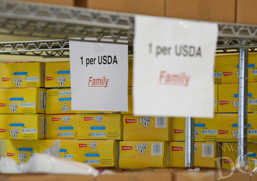 NWA Democrat-Gazette/DAVID GOTTSCHALK  Available food items sit on the shelf before distribution Wednesday, November 2, 2016, at the Bread of Life food pantry at First United Methodist Church in Springdale.