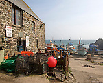 Fishing boats on the beach at the historic and attractive fishing village of Cadgwith Cove on the Lizard Peninsula, Cornwall, England