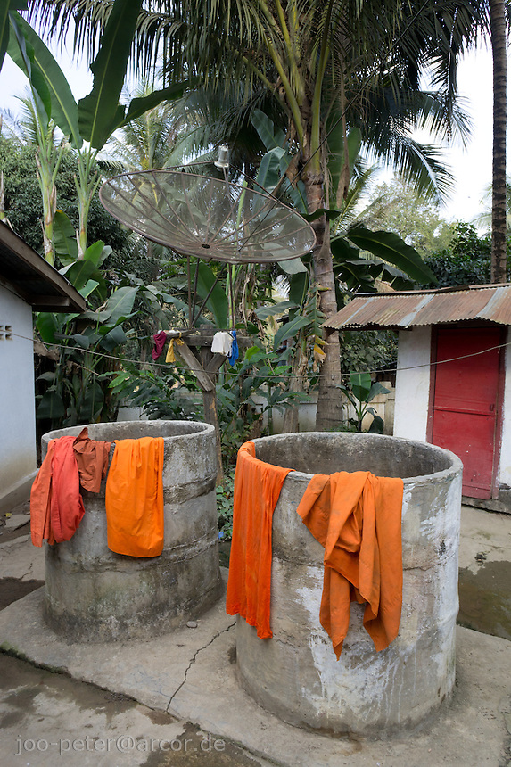 robes of buddhist monks dry in the sun on dwells after washing, monastry in Luang Prabang, Laos, 2012
