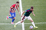 Atletico de Madrid's Jose Maria Gimenez (l) and Club Atletico Osasuna's Oier Sanjurjo during La Liga match. April 15,2017. (ALTERPHOTOS/Acero)