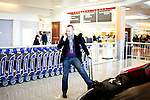 Vincent Gesquiere talks on the phone as he waits for his luggage in Hartsfield-Jackson Atlanta International Airport in Atlanta, Georgia after a flight from Brussels January 6, 2009.