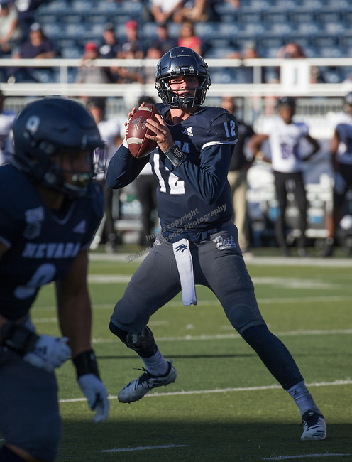 Nevada's Carson Strong (12) drops back to pass in the Nevada vs Weber State football game in Reno, Nevada on Saturday, Sept. 14, 2019.