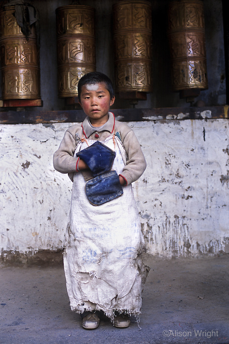 Boy prostrating at temple, Jyekundo, Kham, Tibet, 2005