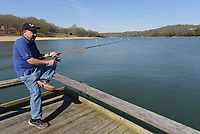 NWA Democrat-Gazette/FLIP PUTTHOFF <br /> FINE FISHING DAY<br /> Jose Merlos of Rogers enjoys a morning of fishing Tuesday April 9 2019 from the public fishing dock at Prairie Creek park on Beaver Lake. The Arkansas Game and Fish Commission has placed fish attractors around the dock to help anglers catch fish.