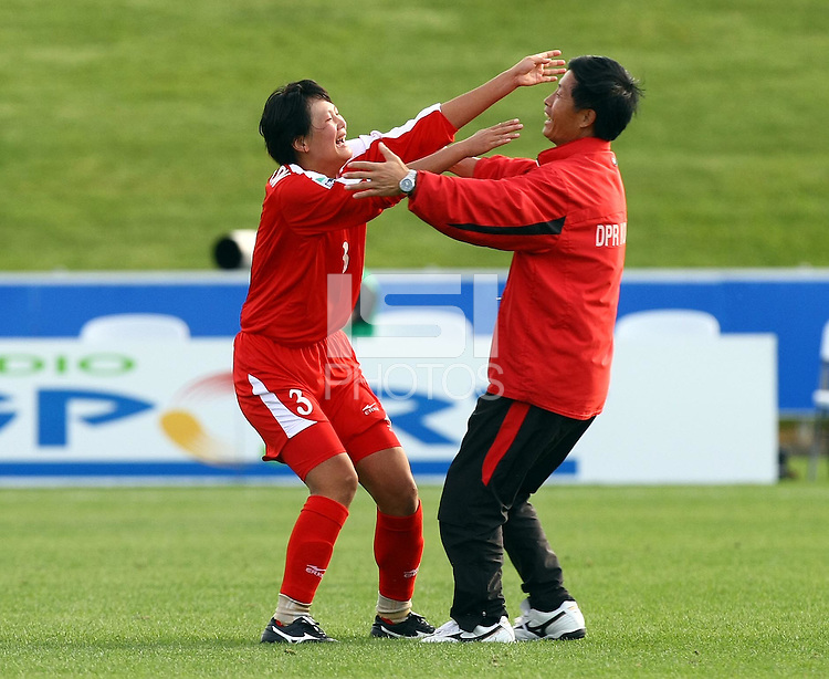 Hong Yon Jon celebrates her teams win with coach Ham Ri Ui. FIFA U17 Women's World Cup Final, USA v Korea DPR, Albany Stadium, Auckland, New Zealand, Sunday 16 November 2008. Photo: Renee McKay/PHOTOSPORT