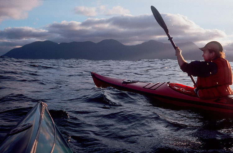 Sea kayakers paddling off Vancouver Island, British Columbia, Canada, Pacific Ocean, North of the Brooks Peninsula