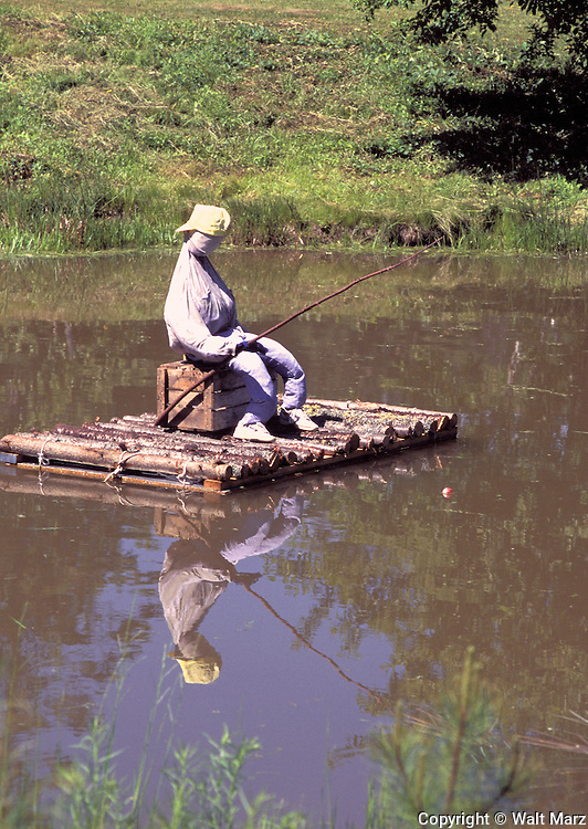 "After doing a double-take as I drove by, stopped to take this picture of the dressed up dummy on a raft on a small pond next to a house in a small village just off Rte 1 in ""Downeast"" Maine."