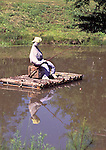 """After doing a double-take as I drove by, stopped to take this picture of the dressed up dummy on a raft on a small pond next to a house in a small village just off Rte 1 in """"Downeast"""" Maine."""