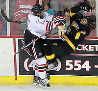 Nebraska-Omaha's Brock Montpetit puts a hit on Colorado College's Eamonn McDermott. Montpetit was whistled for charging. Nebraska-Omaha defeated Colorado College 7-5 Friday night at CenturyLink Center in Omaha. (Photo by Michelle Bishop) .