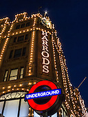 Knightsbridge, London, England. Harrods lights and Underground sign.