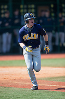 Dan Zuchowski (7) of the Toledo Rockets hustles down the first base line against the Virginia Tech Hokies at The Ripken Experience on February 28, 2015 in Myrtle Beach, South Carolina.  The Hokies defeated the Rockets 1-0 in 10 innings.  (Brian Westerholt/Four Seam Images)