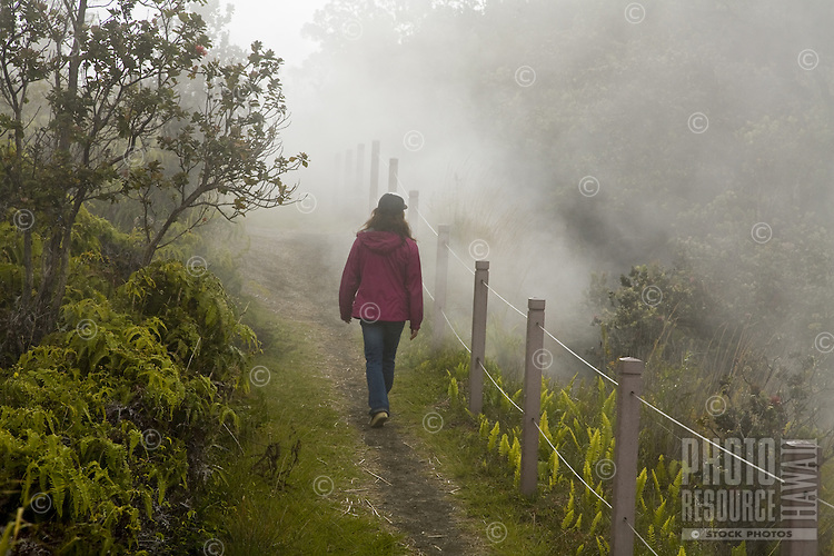 Woman walking past the steam vents at Hawaii Volcanoes National Park