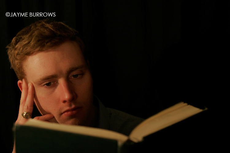 A young man reads.
