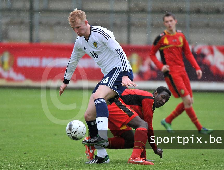 Scotland U19 - Belgium U19 : Mark Beck wins the duel.foto DAVID CATRY / Nikonpro.be