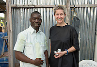 Occidental College professor Mary Beth Heffernan and Dr. Jerry Brown at ELWA 2 Ebola Treatment Unit in Monrovia, Liberia on Thursday, Feb. 26, 2015. Professor Heffernan planned her project with the help of Dr. Brown. Dr. Brown was featured on the December 2014 cover of Time magazine as one of the Persons of the Year for his work during the Ebola outbreak in West Africa.<br /> (Photo by Marc Campos, Occidental College Photographer) Mary Beth Heffernan, professor of art and art history at Occidental College, works in Monrovia the capital of Liberia, Africa in 2015. Professor Heffernan was there to work on her PPE (personal protective equipment) Portrait Project, which helps health care workers and patients fighting the Ebola virus disease in West Africa.<br />