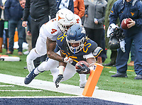 Morgantown, WV - November 18, 2017: West Virginia Mountaineers running back Justin Crawford (25) dives for the pylon during game between Texas and WVU at  Mountaineer Field at Milan Puskar Stadium in Morgantown, WV.  (Photo by Elliott Brown/Media Images International)