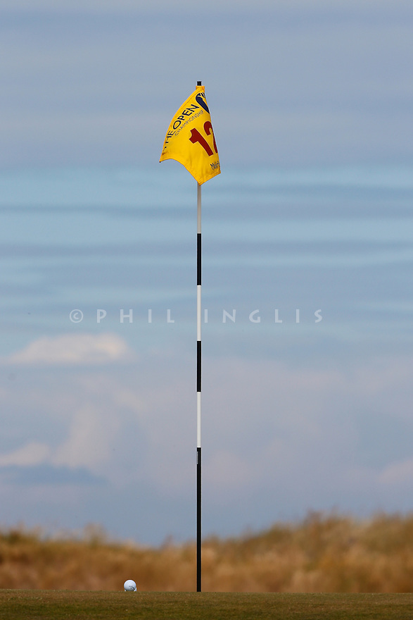 A flag and ball  during the first round The 142nd Open Championship played at Muirfield, Gullane, East Lothian, Scotland. 18 - 22 July 2013 (Picture Credit / Phil Inglis)