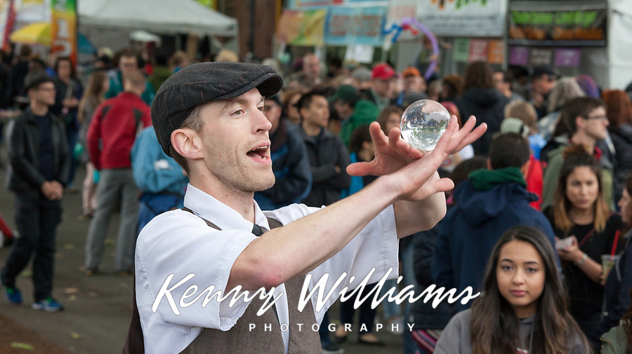 Juggler and crystal ball street performer, Northwest Folklife Festival 2016, Seattle Center, Washington, USA.