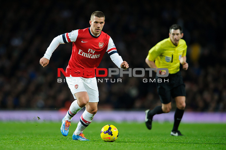 Arsenal Forward Lukas Podolski (GER) in action during the match -  - 18/01/14 - SPORT - FOOTBALL - Emirates Stadium - Arsenal v Fulham - Barclays Premier League.<br /> Foto nph / Meredith<br /> <br /> ***** OUT OF UK *****