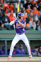 Shortstop Eli White (4) of the Clemson Tigers bats in the Reedy River Rivalry game against the South Carolina Gamecocks on Saturday, February 28, 2015, at Fluor Field at the West End in Greenville, South Carolina. South Carolina won, 4-1. (Tom Priddy/Four Seam Images)