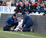 Ian Black gets treatment from doc Paul Jackson and physio Pip Yeates after smashing into the trackside LED boards