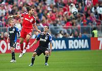 25 September 2010:  Toronto FC forward Dwayne De Rosario #14 and San Jose Earthquakes midfielder Sam Cronin #4 in action during a game between the San Jose Earthquakes and Toronto FC at BMO Field in Toronto..San Jose Earthquakes won 3-2...