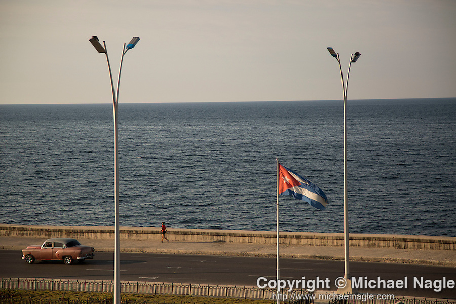 HAVANA, CUBA -- MARCH 23, 2015:  Cars drive along the Malecon in Havana, Cuba on March 23, 2015. Photograph by Michael Nagle